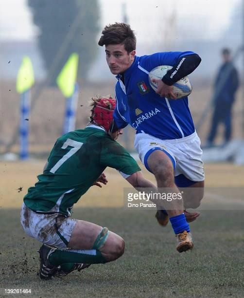 Bruno Lorenzo of Italy U18 tries to tackle to Joe Bercis of Ireland U18 during the U18 rugby test match between Italy U18 and Ireland U18 on February...