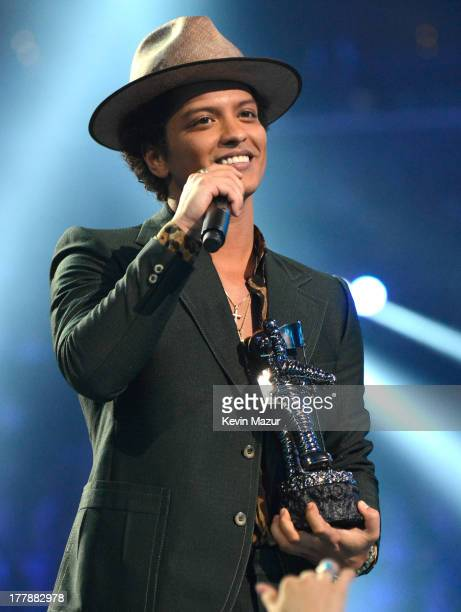 Bruno Mars accepts the Best Male Video award for Locked Out of Heaven during the 2013 MTV Video Music Awards at the Barclays Center on August 25 2013...