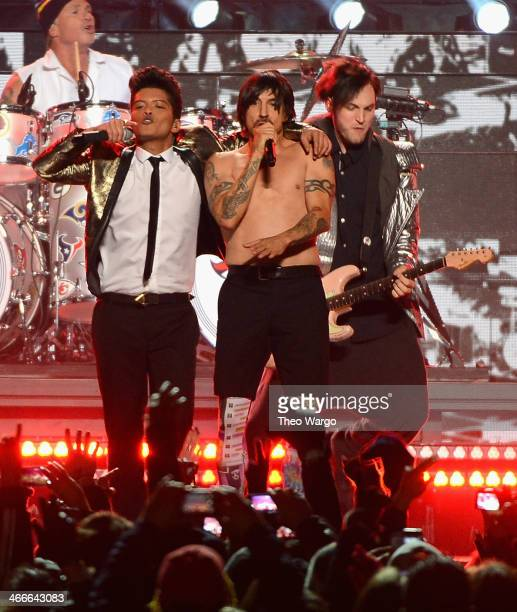 Bruno Mars and Anthony Kiedis and Josh Klinghoffer of the Red Hot Chili Peppers perform during the Pepsi Super Bowl XLVIII Halftime Show at MetLife...
