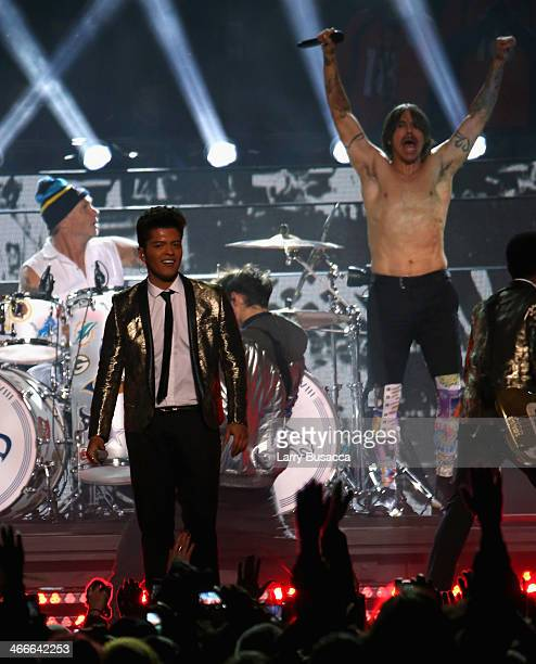 Bruno Mars and Chad Smith and Anthony Kiedis of the Red Hot Chili Peppers perform during the Pepsi Super Bowl XLVIII Halftime Show at MetLife Stadium...