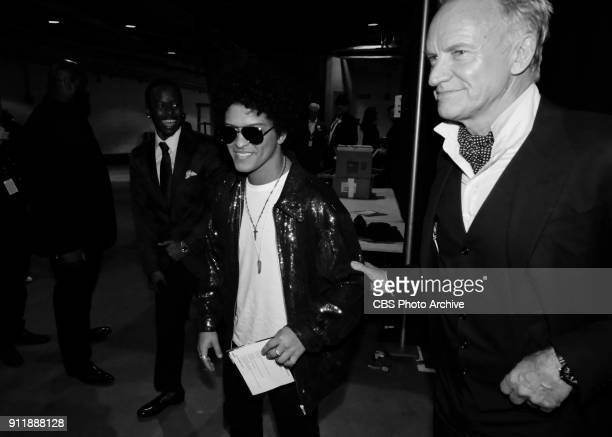 Bruno Mars and Sting backstage at THE 60TH ANNUAL GRAMMY AWARDS broadcast live on both coasts from New York City's Madison Square Garden on Sunday...