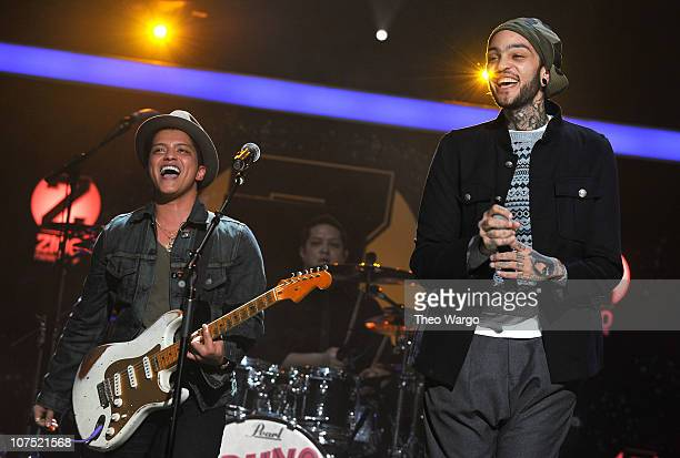 Bruno Mars and Travie McCoy perform onstage during Z100's Jingle Ball 2010 presented by HM at Madison Square Garden on December 10 2010 in New York...