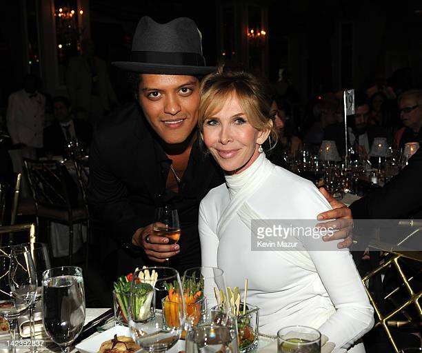 Bruno Mars and Trudie Styler during the auction following the Revlon concert for the Rainforest Fund at The Pierre Hotel on April 3 2012 in New York...