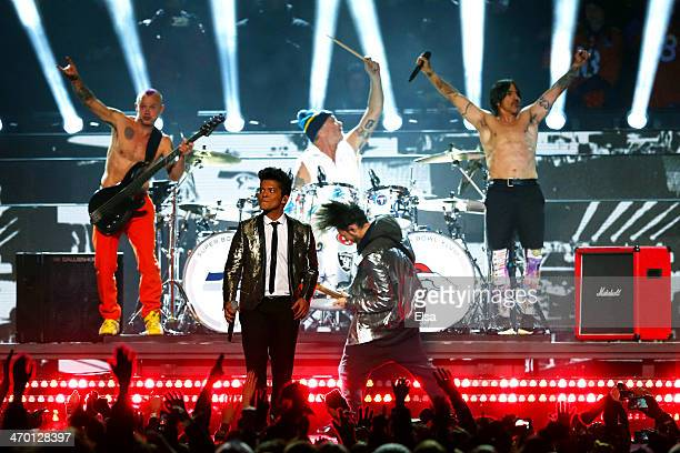 Bruno Mars peforms withe the Red Hot Chili Peppers during the Pepsi Super Bowl XLVIII Halftime Show at MetLife Stadium on February 2 2014 in East...