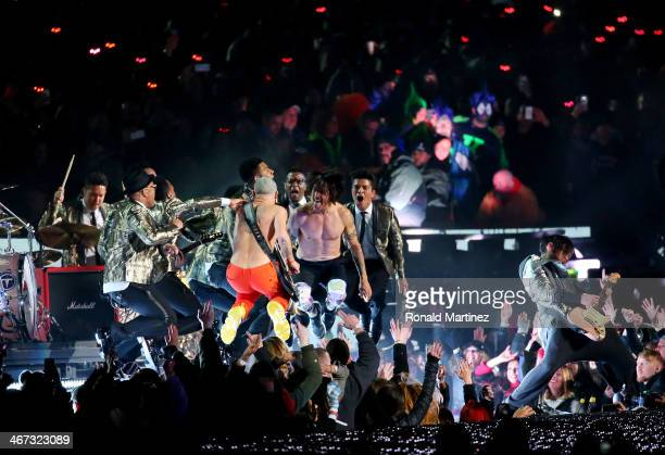 Bruno Mars performs with Anthony Kiedis and Flea of the Red Hot Chili Peppers during the Pepsi Super Bowl XLVIII Halftime Show at MetLife Stadium on...
