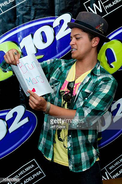 Bruno Mars reads a note from a fan at radio station Q102's Studio Q on September 25 2010 in Philadelphia Pennsylvania