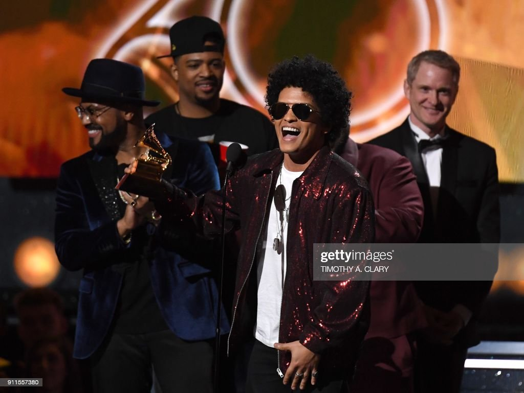 Bruno Mars receives his third Grammy for Album of the Year during the 60th Annual Grammy Awards show on January 28, 2018, in New York. / AFP PHOTO / Timothy A. CLARY