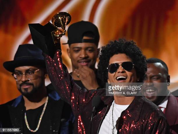 Bruno Mars receives his third Grammy for Album of the Year during the 60th Annual Grammy Awards show on January 28 in New York / AFP PHOTO / Timothy...