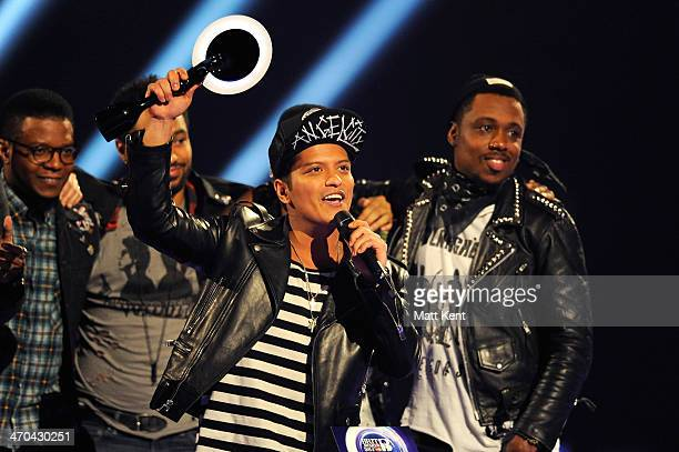 Bruno Mars receives the award for International Male Solo Artist at The BRIT Awards 2014 at 02 Arena on February 19 2014 in London England