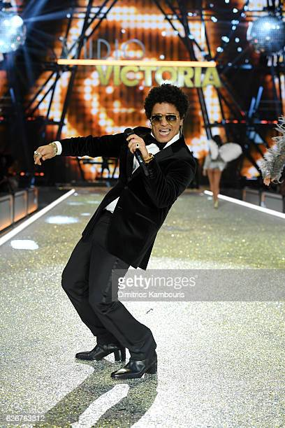 Bruno Mars sings on the runway during the 2016 Victoria's Secret Fashion Show on November 30, 2016 in Paris, France.
