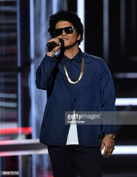 Bruno Mars speaks onstage during the 2018 Billboard Music Awards at MGM Grand Garden Arena on May 20 2018 in Las Vegas Nevada