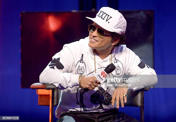 Bruno Mars speaks with host JoJo onstage at iHeartRadio Theater on November 17 2016 in Burbank California