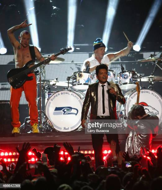 Bruno Mars with Flea and Chad Smith of the Red Hot Chili Peppers perform during the Pepsi Super Bowl XLVIII Halftime Show at MetLife Stadium on...