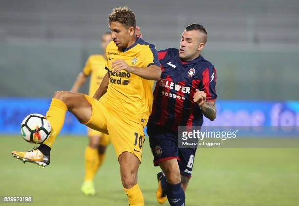 Bruno Martella of Crotone competes for the ball with Alessio Cerci of Verona during the Serie A match between FC Crotone and Hellas Verona FC at...