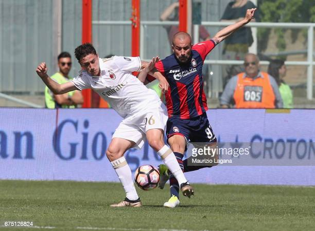Bruno Martella of Crotone competes for the ball with Davide Calabria of Milan during the Serie A match between FC Crotone and AC Milan at Stadio...