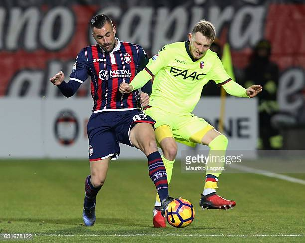 Bruno Martella of Crotone competes for the ball with Ladislav Krejci of Bologna during the Serie A match between FC Crotone and Bologna FC at Stadio...