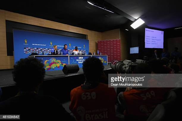 Bruno Martins Indi and Louis van Gaal team manager get ready to speak to the media during the Netherlands Press Conference at the 2014 FIFA World Cup...
