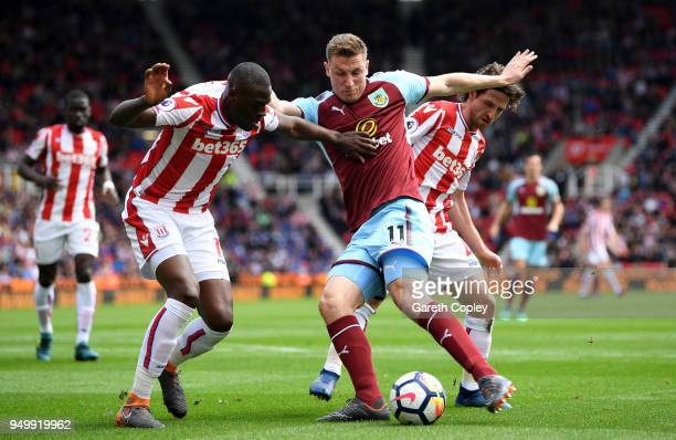 Bruno Martins Indi Joe Allen of Stoke City and Chris Wood of Burnley in action during the Premier League match between Stoke City and Burnley at...