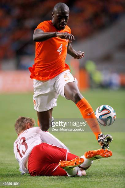 Bruno Martins Indi of Netherlands jumps the tackle from George Williams of Wales during the International Friendly match between The Netherlands and...