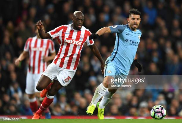 Bruno Martins Indi of Stoke City closes down Sergio Aguero of Manchester City during the Premier League match between Manchester City and Stoke City...