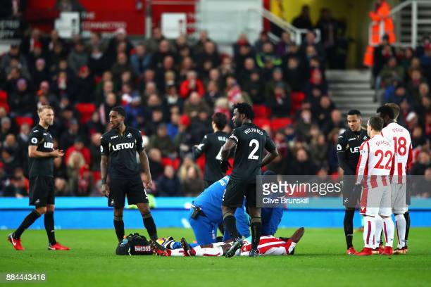 Bruno Martins Indi of Stoke City lies injured during the Premier League match between Stoke City and Swansea City at Bet365 Stadium on December 2...