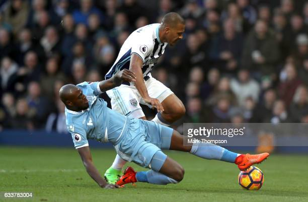 Bruno Martins Indi of Stoke City tackles Jose Salomon Rondon of West Bromwich Albion during the Premier League match between West Bromwich Albion and...