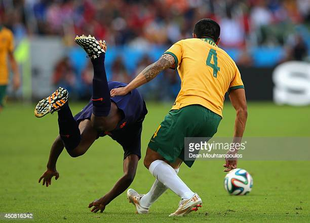 Bruno Martins Indi of the Netherlands falls to the field after a challenge by Australia during the 2014 FIFA World Cup Brazil Group B match between...
