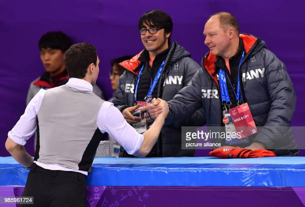 Bruno Massot from Germany speaking with trainer Alexander Koenig during the figure skating pairs short program of the 2018 Winter Olympics in the...