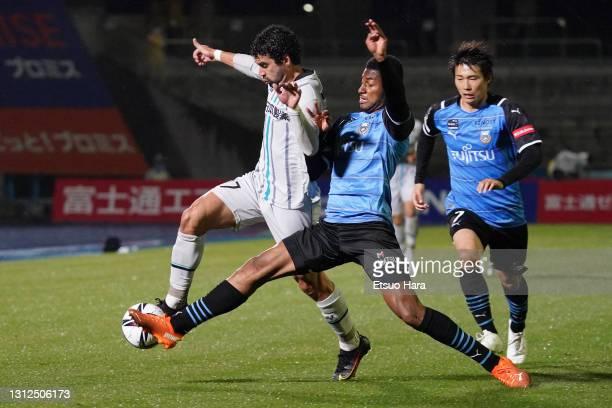 Bruno Mendes of Avispa Fukuoka and Jesiel of Kawasaki Frontale compete for the ball during the J.League Meiji Yasuda J1 match between Kawasaki...