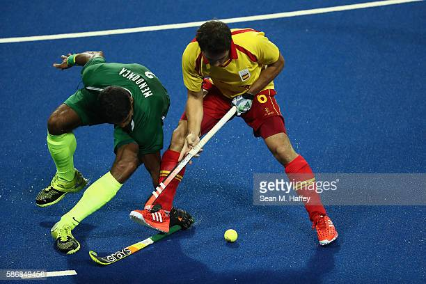 Bruno Mendonca of Brazil battles Miguel Delas of Spain for a loose ball during a Men's Pool A match between Brazil and Spain on Day 1 of the Rio 2016...