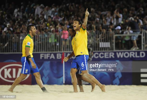 Bruno of Brazil celebrates with teammates Bruno Xavier and Eudin during the FIFA Beach Soccer World Cup Tahiti 2013 Group C match between Brazil and...