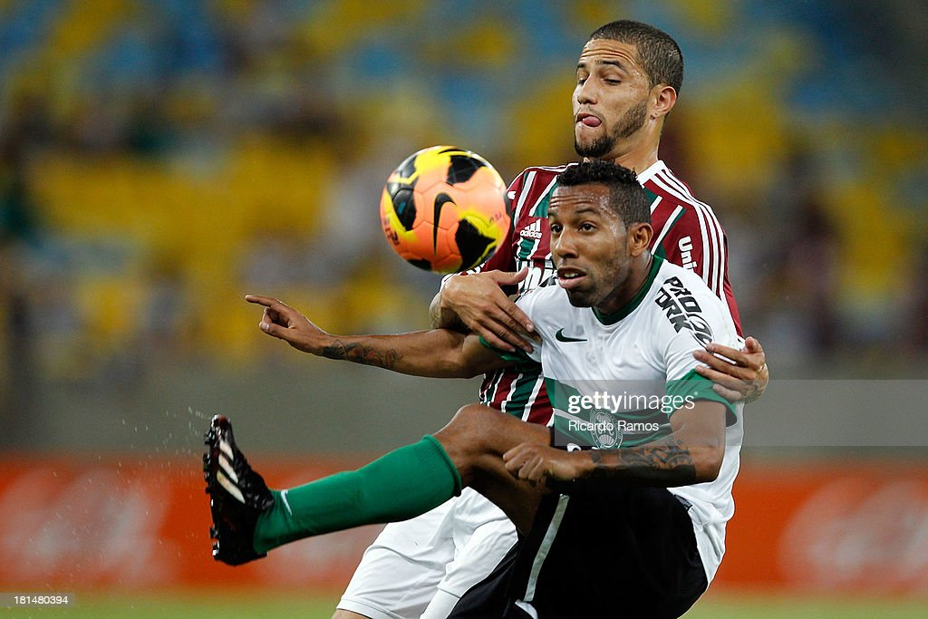 Bruno of Fluminense fights for the ball with Vitor Junior of Coritiba during the match between Fluminense and Coritiba for the Brazilian Series A 2013 at Maracana on September 21, 2013 in Rio de Janeiro, Brazil.
