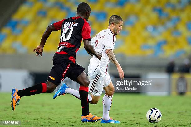 Bruno of Fluminense struggles for the ball with Hugo of Vitoria during a match between Fluminense and Vitoria as part of Brasileirao Series A 2014 at...