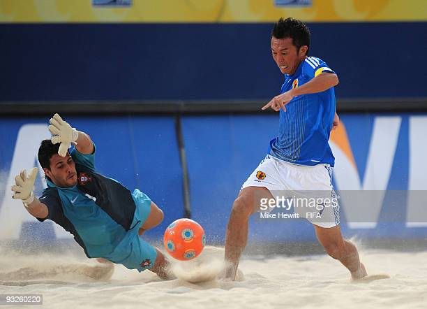 Bruno of Portugal dives at the feet of Takeshi Kawaharazuka of Japan during the FIFA Beach Soccer World Cup Quarter Final match between Japan and...