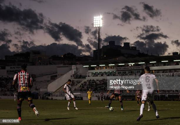 Bruno of Sao Paulo battles for the ball with Joao Lucas and Yuri of Ponte Preta during the match between Ponte Preta and Sao Paulo as a part of...