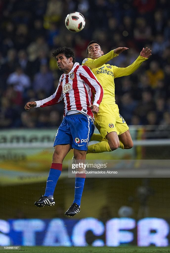 Bruno (R) of Villarreal duels for the ball with Diego Costa of Atletico de Madrid during the La Liga match between Villarreal and Atletico de Madrid at El Madrigal on October 24, 2010 in Villarreal, Spain.