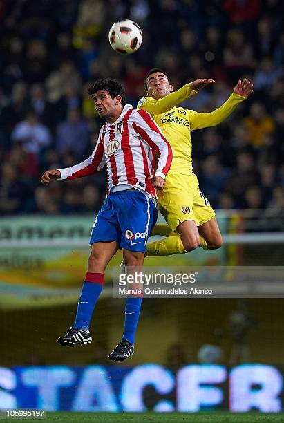 Bruno of Villarreal duels for the ball with Diego Costa of Atletico de Madrid during the La Liga match between Villarreal and Atletico de Madrid at...