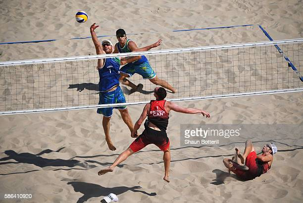 Bruno Oscar Schmidt and Alison Cerutti of Brazil and Josh Binstock and Samuel Schachter of Canada in action during the Men's Beach Volleyball...