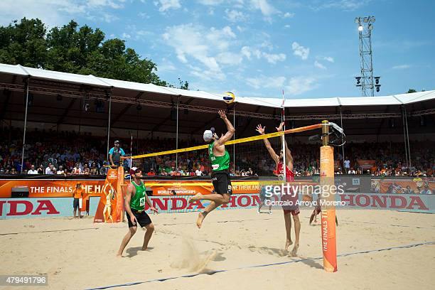 Bruno Oscar Schmidt from Brazil attacks Theodore Brunner from the United States during the FIVB Beach Volleyball World Championships Male Semifinal...