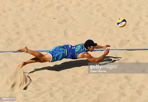 Bruno Oscar Schmidt of Brazil dives for the ball during the Men's Beach Volleyball preliminary round Pool A match against Josh Binstock and Samuel...