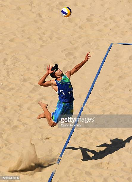 Bruno Oscar Schmidt of Brazil serves the ball during the Men's Beach Volleyball preliminary round Pool A match against Josh Binstock and Samuel...