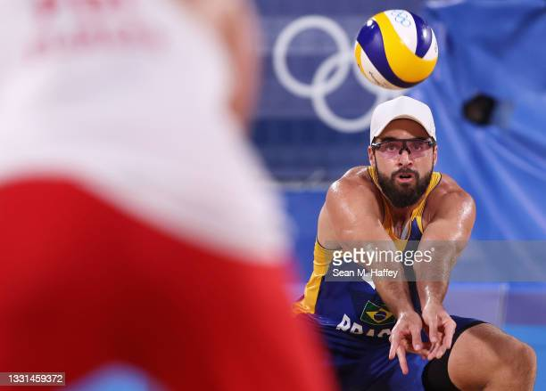 Bruno Oscar Schmidt of Team Brazil competes against Team Poland during the Men's Preliminary - Pool E beach volleyball on day seven of the Tokyo 2020...