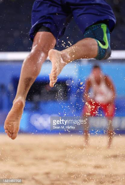 Bruno Oscar Schmidt of Team Brazil serves against Team Poland during the Men's Preliminary - Pool E beach volleyball on day seven of the Tokyo 2020...