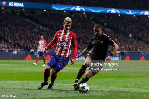 Bruno Peres of AS Roma and Antoine Griezmann of Atletico Madrid battle for possession during the UEFA Champions League group C match between Atletico...