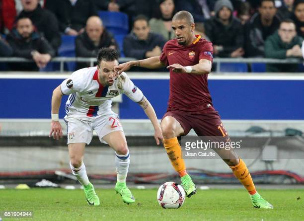 Bruno Peres of AS Roma and Mathieu Valbuena of Lyon in action during the UEFA Europa League Round of 16 first leg match between Olympique Lyonnais...