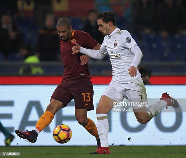 Bruno Peres of AS Roma competes for the ball with Mattia De Sciglio of AC Milan during the Serie A match between AS Roma and AC Milan at Stadio...