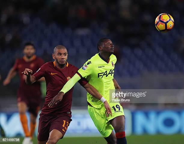 Bruno Peres of AS Roma competes for the ball with Umar Sadiq of Bologna FC during the Serie A match between AS Roma and Bologna FC at Stadio Olimpico...