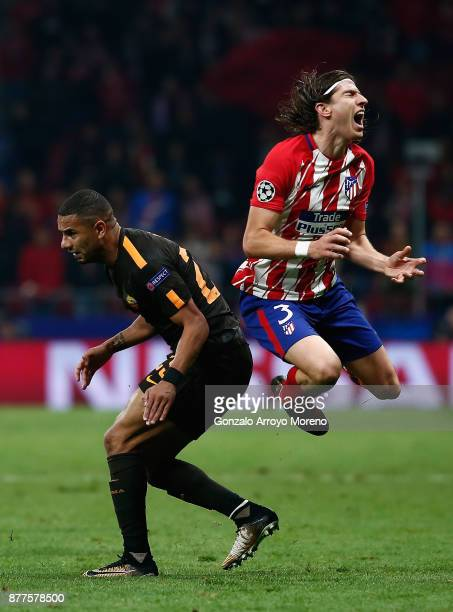 Bruno Peres of AS Roma fouls Filipe Luis of Atletico Madrid leading to his sending off during the UEFA Champions League group C match between...