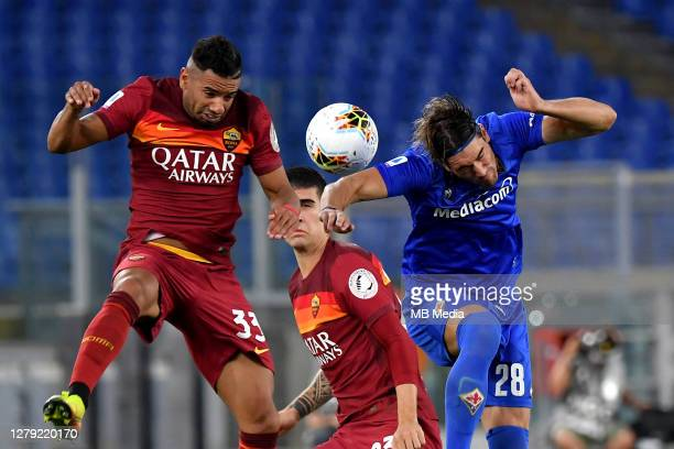 Bruno Peres of AS Roma heads the ball against Dusan Vlahovic of ACF Fiorentina ,during the Serie A match between AS Roma and ACF Fiorentina at Stadio...