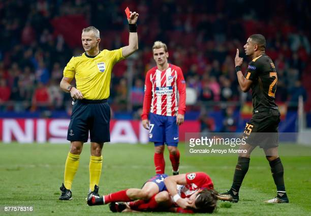 Bruno Peres of AS Roma is shown a red card by referee Bjorn Kuipers after fouling Filipe Luis of Atletico Madrid during the UEFA Champions League...